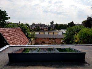 Houten lessenaarsdak vrij op het dak 6.6